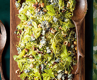Warm Shaved Brussels Sprout Salad with Roquefort & Hazelnuts