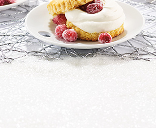 Cornmeal Shortcakes topped with Fresh Cream & Candied Cranberries