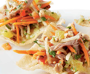 Grand Marnier-Marinated Pulled Duck with Asian-Style Slaw on Crispy Won Tons