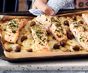 Salmon Roasted on Potatoes with Olives & Green Sauce