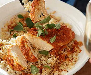 Piri-Piri-Braised Chicken Over Cauliflower Rice